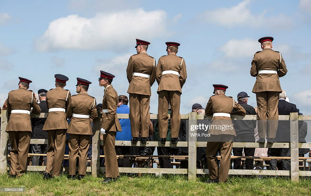 Soldiers of the Royal Artillery watch the Artillery's 300th anniversary celebrations at Knighton Down on May 26, 2016 in Lark Hill, England. Queen Eliabeth II has been Captain-General of the Royal Regiment of Artillery since 6 February 1952.