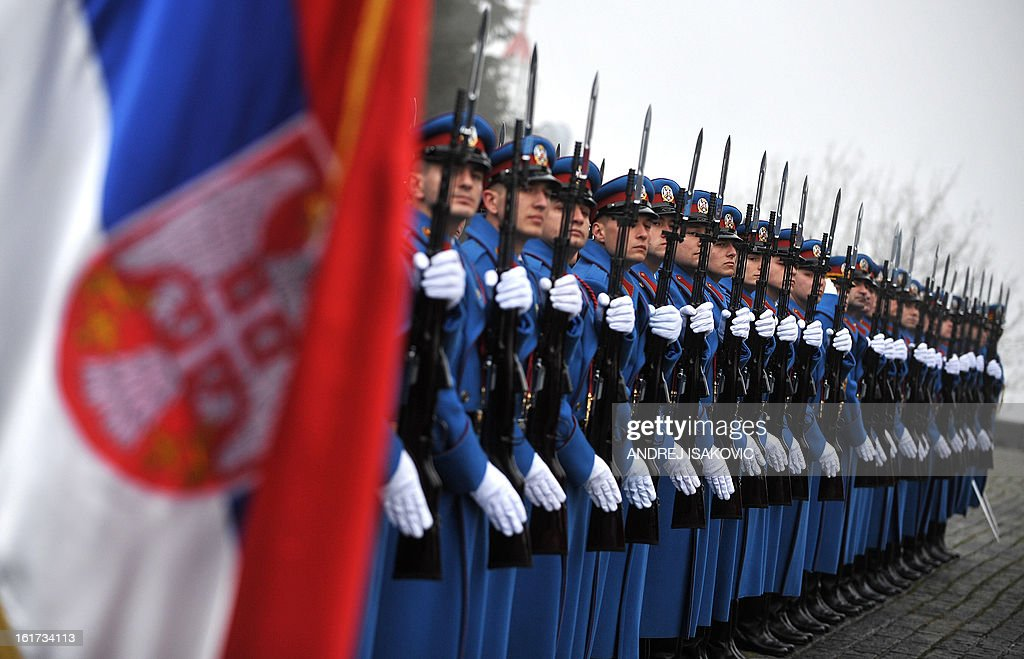 Soldiers of the Serbian Army honour guard stand still during a ceremony at the monument of the Unknown Soldier on mount Avala near Belgrade, on February 15, 2013, on Serbia's Statehood Day, a celebration of the 209th anniversary of the first Serbian uprising and the creation of the modern Serbian state.