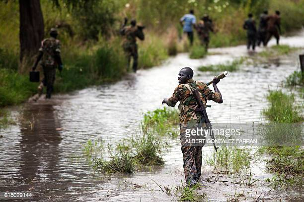 Soldiers of the Sudan People Liberation Army cross the Nile River on foot near Malakal northern South Sudan on October 16 2016 Heavy fighting broke...
