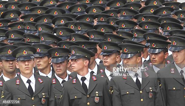 Soldiers of the Turkish Armed Forces parade on August 30 2014 in Ankara during ceremonies marking the 92nd anniversary of the Victory Day...