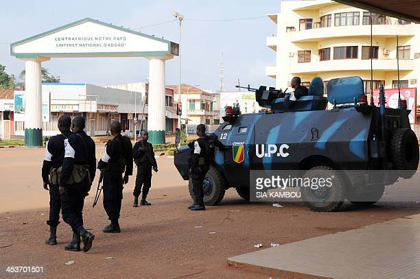 Soldiers of the UPC Congo part of the Micopax stand guard near the presidential palace on December 5 2013 in Bangui as shots rang out and blasts from...