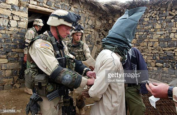 Soldiers of the US 82nd airborne flexcuff and blindfold an Afghan man during Operation Alamo Sweep in Southeastern Afghanistan The US military refers...