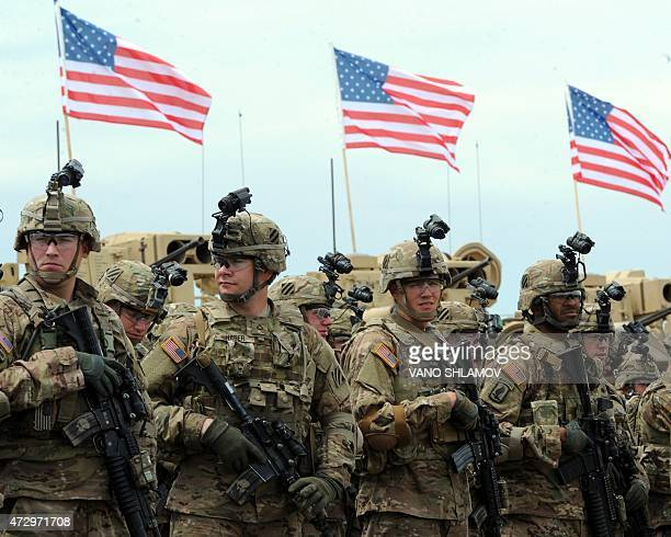 Soldiers of the US mechanized infantry company from the 1st Brigade 3rd Infantry Division look on during an official opening ceremony of the joint...