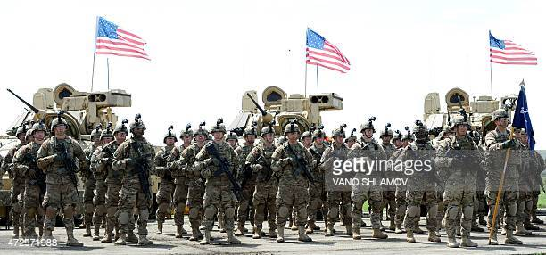 Soldiers of the US mechanized infantry company from the 1st Brigade 3rd Infantry Division stand to attention during an official opening ceremony of...