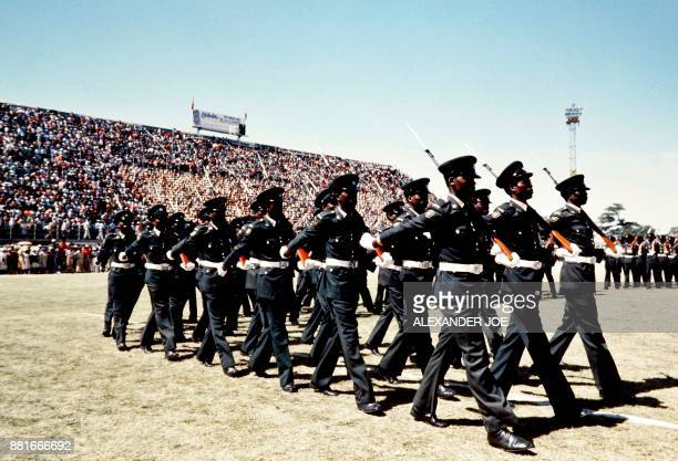 Soldiers of the Zimbabwean army parade in May 1984 at the Rufaro stadium in Harare / AFP PHOTO / ALEXANDER JOE