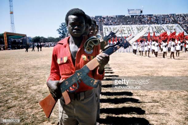 Soldiers of the Zimbabwean youth brigades militias parades in May 1984 at the Rufaro stadium in Harare / AFP PHOTO / ALEXANDER JOE
