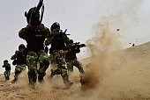 Soldiers of Xinjiang Armed Police Frontier Corps get drill in gobi desert of Yecheng County on August 17 2015 in Kashgar Xinjiang Uygur Autonomous...