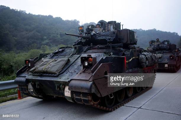 S soldiers on M2 Bradley armored vehicles take part during the Warrior Strike VIII exercise at the Rodriguez Range on September 19 2017 in Pocheon...