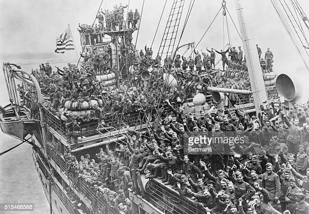 Soldiers on the USS Agamemnon cheer as they return home from battles in France The deck of the ship is crowded with cheering soldiers Hoboken New...