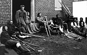 Soldiers outside a brick hospital building in Fredericksburg Virginia recovering from wounds received during the battles in the 'Wilderness campaign'...