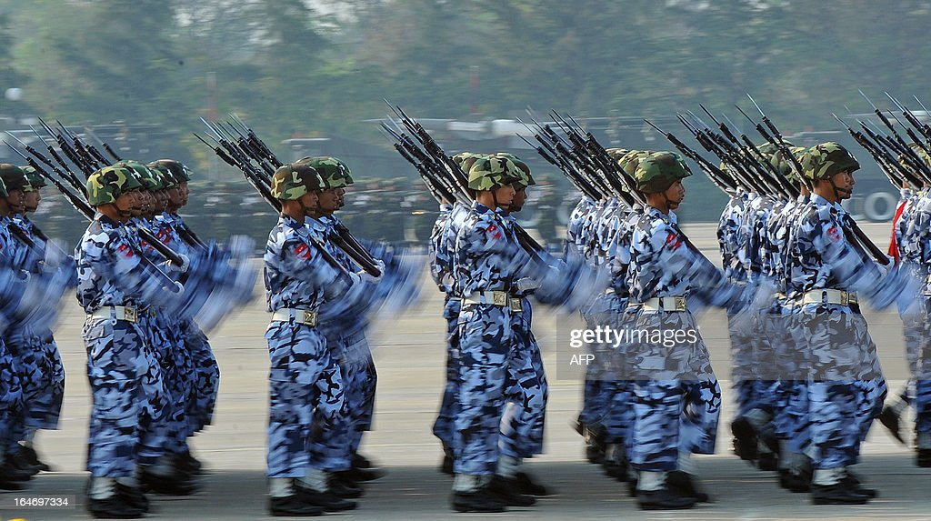 Soldiers parade during a ceremony marking Myanmar's 68th Armed Forces Day at a parade ground in Naypyidaw on March 27, 2013. Opposition leader Aung San Suu Kyi attended Myanmar's Armed Forces Day for the first time. AFP PHOTO / Ye Aung THU