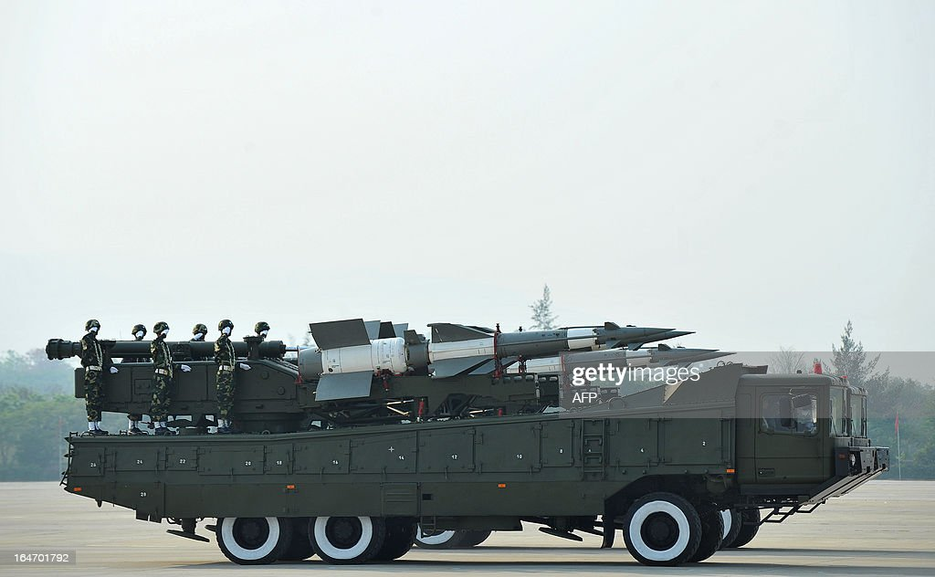 Soldiers parade on armoured vehicles carrying missiles during a ceremony marking Myanmar's 68th Armed Forces Day at a parade ground in Naypyidaw on March 27, 2013. Opposition leader Aung San Suu Kyi attended Myanmar's Armed Forces Day for the first time. AFP PHOTO / Ye Aung THU
