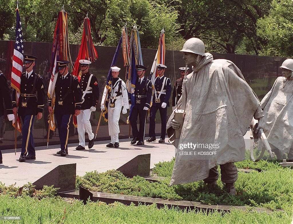 US soldiers parade past the Korean War Memorial during a commemorative ceremony 25 March 2000 in Washington DC marking the 50th anniversary of the...
