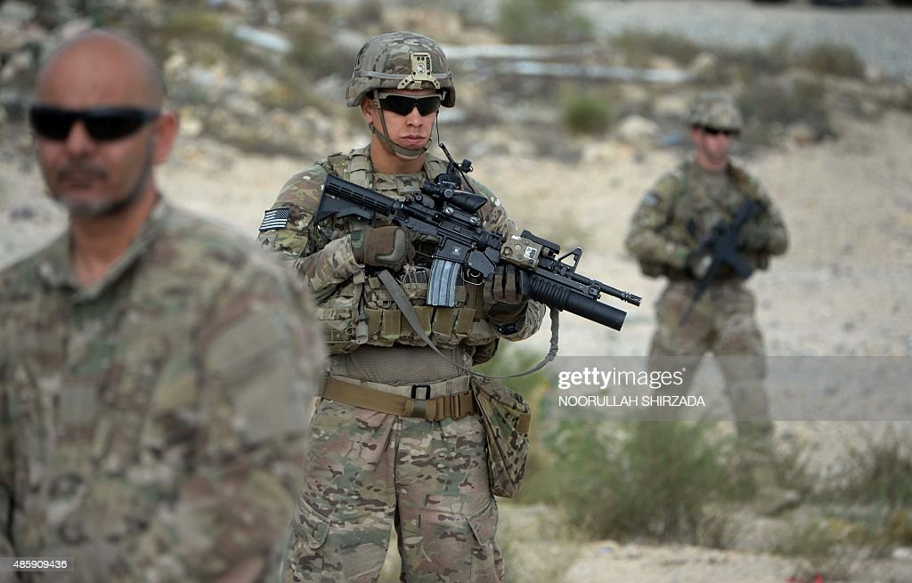US soldiers part of NATO patrol during the final day of a month long anti-Taliban operation by the Afghan National Army (ANA) in various parts of eastern Nangarhar province, at an Afghan National Army base in Khogyani district on August 30, 2015. Afghan security forces launched a joint anti-militant operation in three districts, killing over 150 armed insurgents and wounding 112 others with 13 security personnel killed and three others were wounded in the past 30 days, Afghan National Army Commander Zaman Waziri said. AFP PHOTO / Noorullah Shirzada