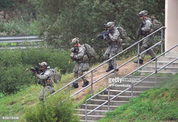 US soldiers participate in a South KoreaUS combined arms collective training exercise at the US army's Rodriguez shooting range in Pocheon about 70...