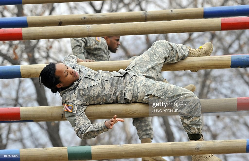 US soldiers pass over an obstacle during an Air Assault training course at a US Army base in Dongducheon, 40 kms north of Seoul, on February 26, 2013. About 250 US soldiers from the 2nd Infantry Division located in South Korea took part in the two-week course until March 8, focused on combat assault operations involving US Army rotary-wing aircraft.