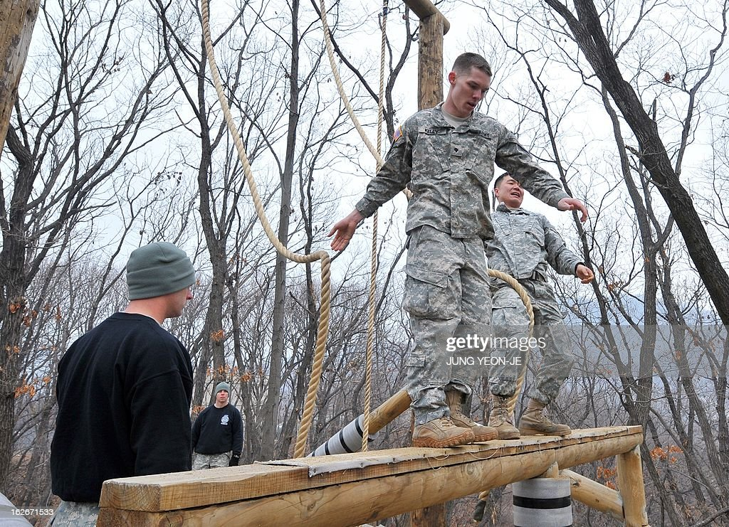 US soldiers pass over an obstacle during an Air Assault training course at a US Army base in Dongducheon, 40 kms north of Seoul, on February 26, 2013. About 250 US soldiers from the 2nd Infantry Division located in South Korea took part in the two-week course until March 8, focused on combat assault operations involving US Army rotary-wing aircraft. AFP PHOTO / JUNG YEON-JE