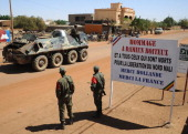 Soldiers patrol aboard a armoured vehicule on February 14 2013 in a street of the city of Gao northern Mali Mali risks descending into 'catastrophic'...