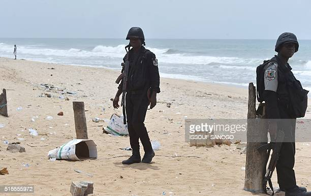 Soldiers patrol on the beach on March 14 2016 in Grand Bassam a day after gunmen attacked the Ivory Coast resort town popular with Ivorians and...