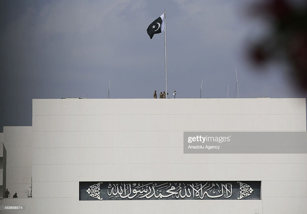 Soldiers patrol on the roof of presidency building as followers of the Pakistan Tehreek-e-Insaf (PTI) and the Pakistan Awami Tehreek (PAT) parties enter Pakistani capital Islamabad's sensitive Red Zone area, which houses state buildings, on August 20, 2014. Thousands of protesters loyal to opposition politician Imran Khan and religious scholar Dr Tahir-ul-Qadri started their march on the parliament house after the two leaders asked their supporters to enter the Red Zone, a heavily protected area where many official and diplomatic buildings are located.