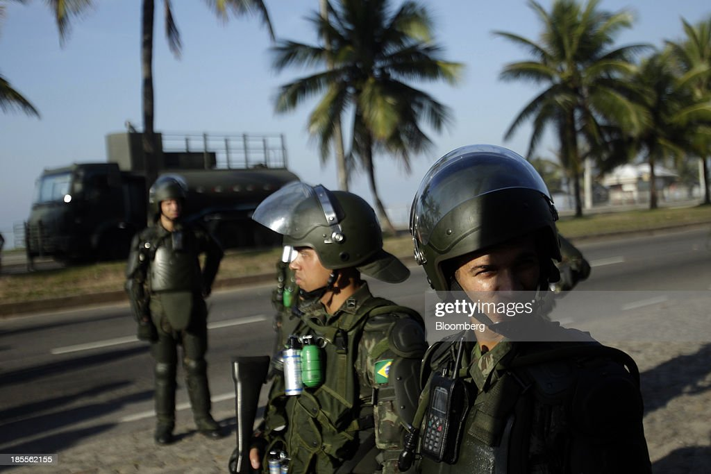 Soldiers patrol outside the Windsor Barra Hotel in Rio de Janeiro, Brazil, on Monday, Oct. 21, 2013. Soldiers, army vehicles, helicopters and navy ships are guarding a Rio de Janeiro hotel where companies including China National Petroleum Corp., Royal Dutch Shell Plc and Total SA are expected to vie for one of the worlds two largest offshore fields at 3 p.m. local time, as oil workers protest the concession. Photographer: Dado Galdieri/Bloomberg via Getty Images