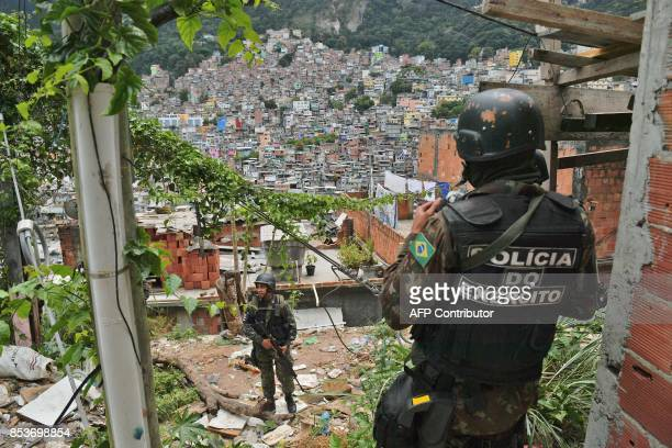 TOPSHOT Soldiers patrol the Rocinha favela in Rio de Janeiro Brazil on September 25 2017 On September 22 950 soldiers were deployed to reinforce...