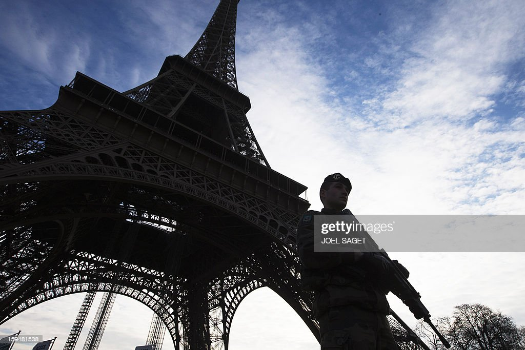 Soldiers patrol under the Eiffel Tower on 14January 2013 in Paris. Islamist forces based in northern Mali vowed Monday to avenge France's fierce military offensive against them on French soil. AFP PHOTO/JOEL SAGET