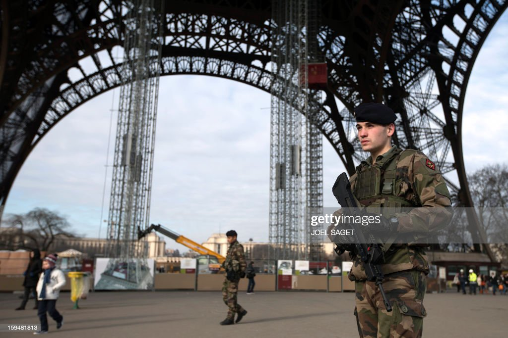 Soldiers patrol under the Eiffel Tower on January 14, 2013 in Paris. Islamist forces based in northern Mali vowed Monday to avenge France's fierce military offensive against them on French soil.