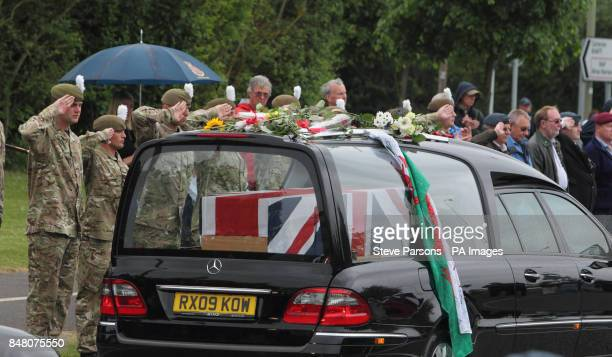 Soldiers pay their respects to Captain Stephen Healey from the 1st Battalion The Royal Welsh Guards as his body passes the Memorial Garden in...