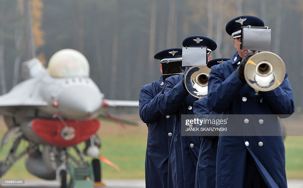 US soldiers play trumpets as a detachment of 10 U.S. airmen opens America's first permanent military mission in Poland at the air base in Lask, central Poland, on November 9, 2012 2012.The mission is a sign of good defense partnership between Washington and Warsaw, which has been supporting the U.S. administration in military missions in Iraq and Afghanistan../