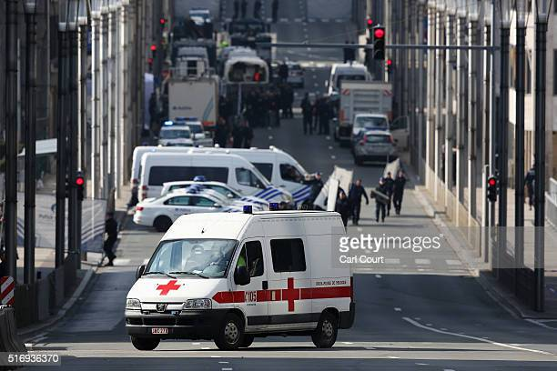 Soldiers police officers and medical personnel attend the scene at the Maelbeek metro station following todays attack on March 22 2016 in Brussels...