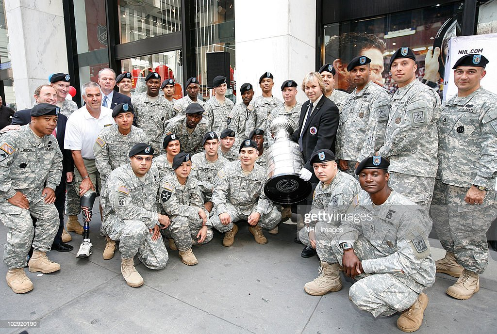 Soldiers pose with the Stanley Cup at the NHL, UPS & U.S. Army Street Hockey Equipment Donation To Troops In Iraq event at NHL Powered by Reebok Store on June 7, 2010 in New York.