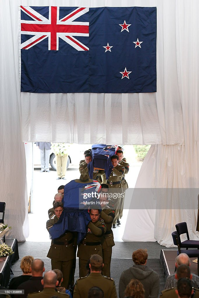 Soldiers Pralli Durrer and Rory Malone are carried into the service at the Military Commemorative Service for LCPL Durrer and LCPL Malone at Burnam Military Camp on August 11, 2012 in Christchurch, New Zealand. The bodies of the two New Zealand soldiers killed in Afghanistan arrived in Christchurch last night. Private funeral services will then be held by their families.