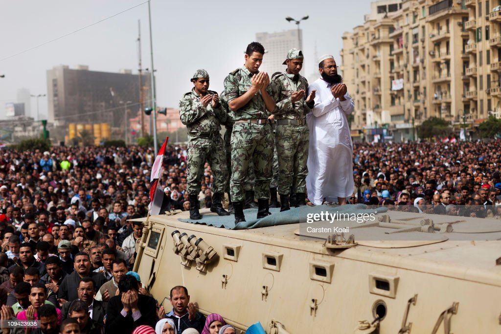 Soldiers pray on top of a tank during antigovernment protests and Friday prayers in Tahrir Square Feburary 25 2011 in Cairo Egypt Hundreds of...