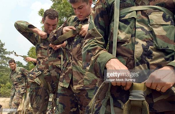 Soldiers prepare equipment as the 525th Military Intelligence Brigade conducts aerial recovery training July 19 2006 at Fort Bragg in North Carolina...