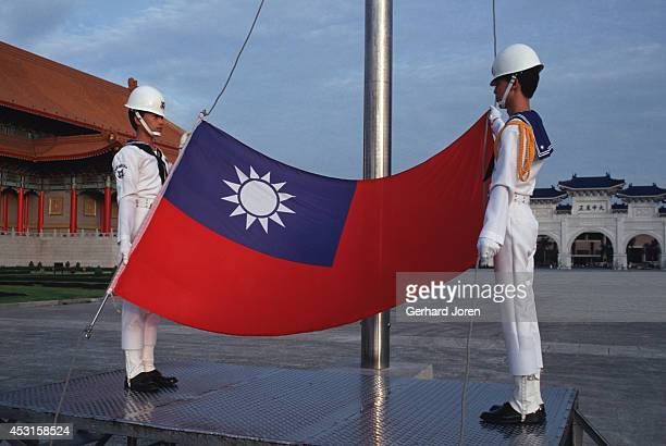Soldiers prepare to raise the Taiwanese flag at Chiang Kai Shek Plaza in Taipei