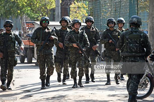 Soldiers provide security during the visit of Brazil's President Dilma Rousseff candidate of the Workers' Party for October's presidential election...