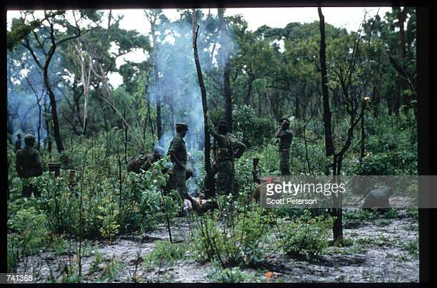 UNITA soldiers put out cooking fires January 23 1990 near Jamba Angola The National Union for the Total Independence of Angola and the Marxist forces...