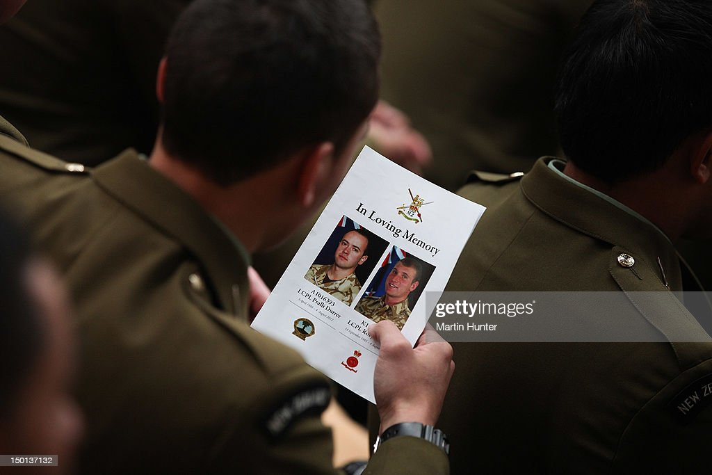 Soldiers read a Service Card at the Military Commemorative Service for LCPL Durrer and LCPL Malone at Burnam Military Camp on August 11, 2012 in Christchurch, New Zealand. The bodies of the two New Zealand soldiers killed in Afghanistan arrived in Christchurch last night. Private funeral services will then be held by their families.