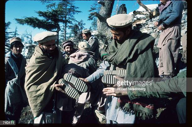 Soldiers receive new boots at a remote guerrilla base in the Safed Koh Mountains February 10 1988 in Afghanistan A Sovietsupported communist coup by...