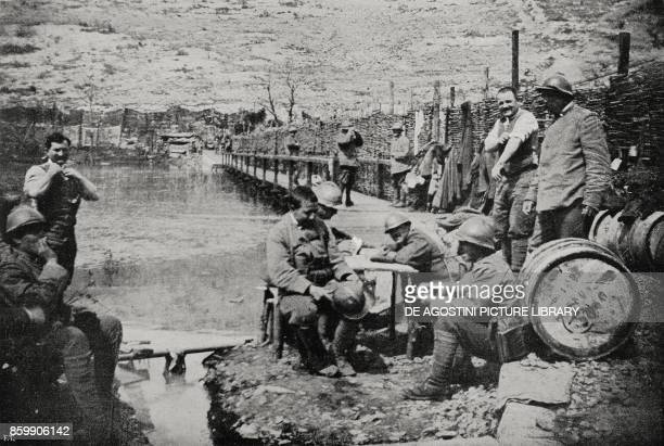 Soldiers resting near a footbridge over the Isonzo river Italy World War I from L'Illustrazione Italiana Year XLIV No 28 July 15 1917