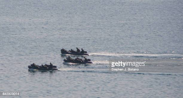 SATTAHIP CHONBURI THAILAND Soldiers ride on assault boats before securing the beach head during the ongoing USThai joint military exercise titled...