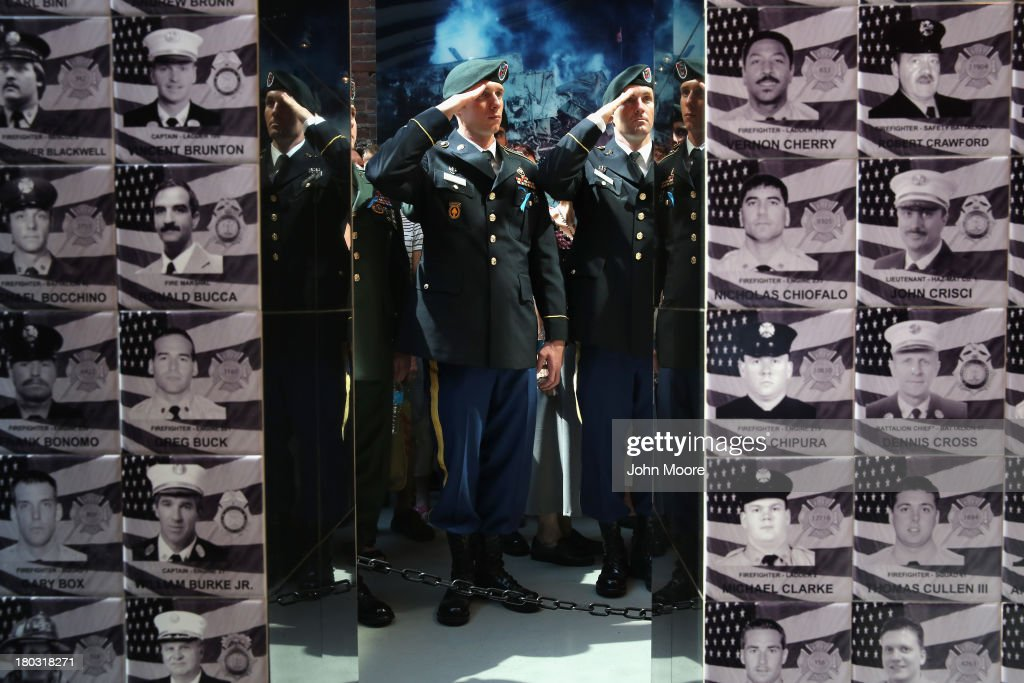 U.S. soldiers salute at a memorial to the 343 firefighters who died during the 9/11 attacks on September 11, 2013 in New York City. The New York City fire department (FDNY) held a wreath-laying ceremony at the New York City Fire Museum to commemorate the 12th anniversary of the terrorist attacks.