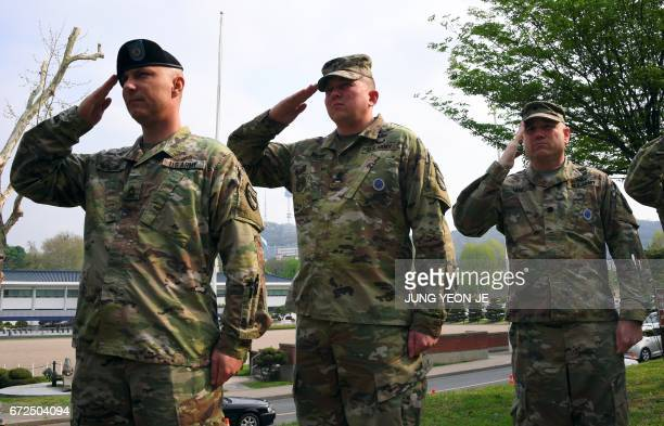 US soldiers salute during the General Walker Monument Transition Ceremony at a US Army base in Seoul on April 25 2017 marking the beginning of the US...