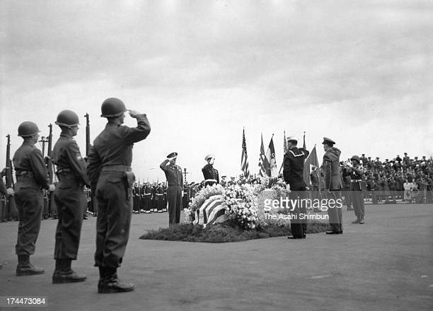 Soldiers salute to a coffin of US soldier died in the line of duty during the Korean War at a memorial ceremony in March 1951 in Yokohama Kanagawa...