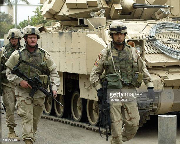 US soldiers secure a street following a car bomb close to the Dubaibased AlArabiya satellite station in the Mansour district of Baghdad 30 October...