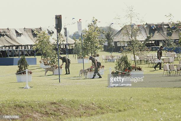 Soldiers secure the venue before Queen Elizabeth II's visit to Ulster in Northern Ireland 1977