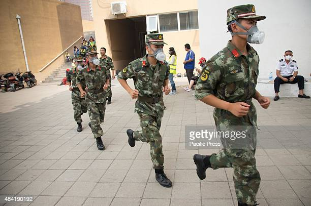 Soldiers seen wearing gas masks in the exclusion zone as the authority had confirmed the existent of toxic gas in the area The death toll has risen...