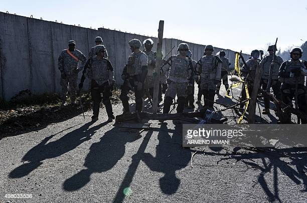 US soldiers serving in the NATOled peacekeeping force take part in a crowd and riot control exercise near the village of Vrelo on November 20 2015...