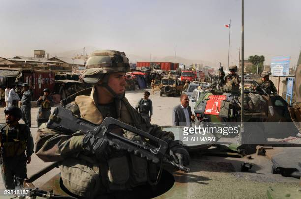 Soldiers serving with the NATOled International Security Assistance Force secure the site of a suicide car bomb in Kabul on August 18 2009 Attacks...